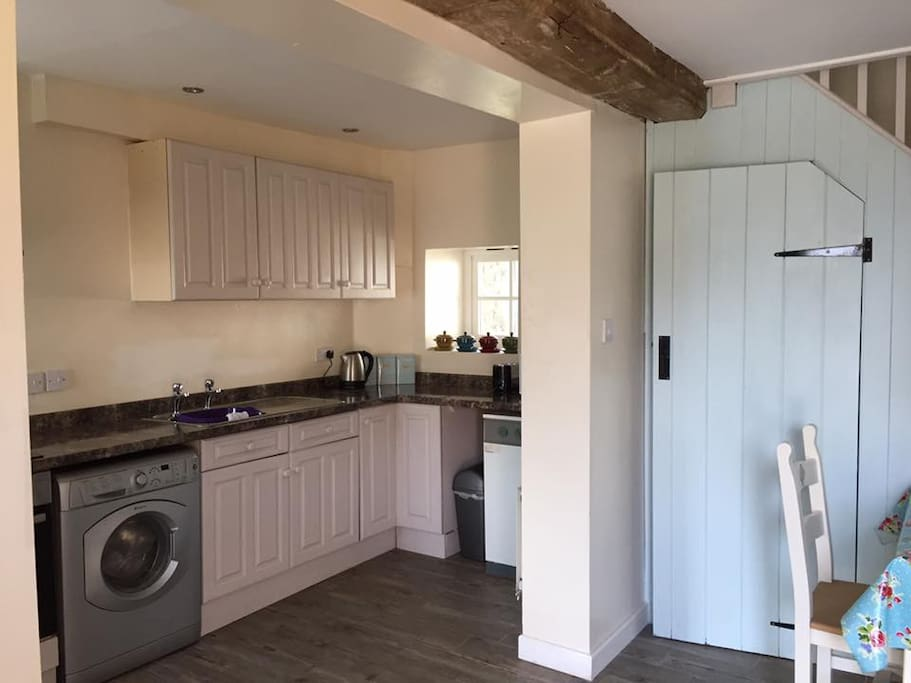Fully fitted kitchen with washing machine.