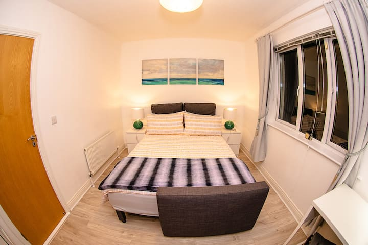 Guest Bedroom - You can pull down the blinds and close the curtains, if you need total darkness
