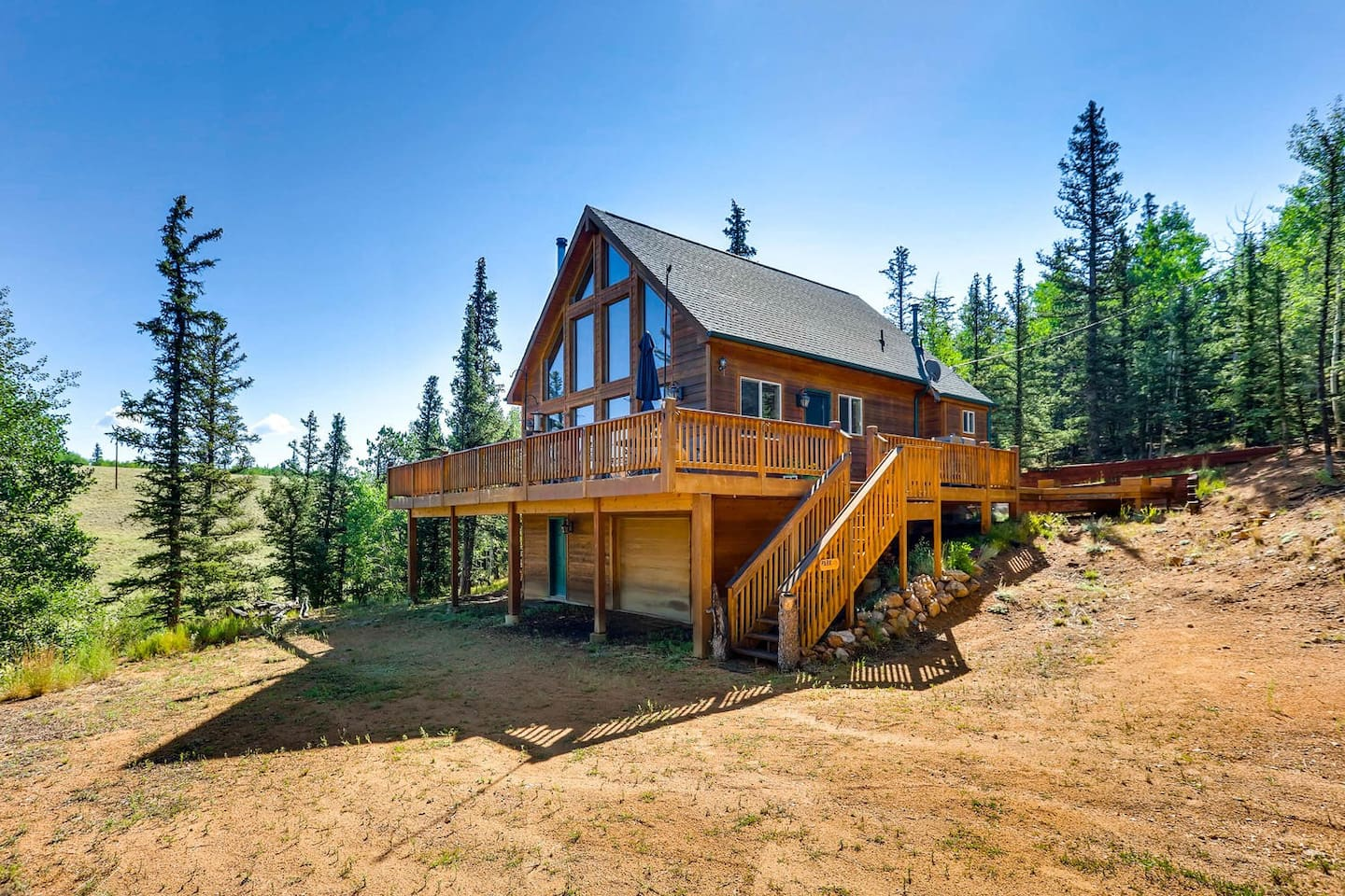 This beautiful home is located atop a mountain on a wooded and secluded property. The views of the white-capped mountains are breath-taking!
