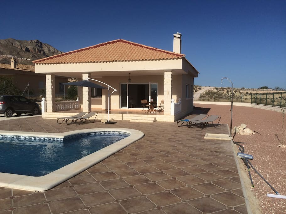 front view with our pool and outside shower