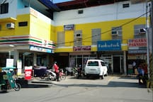 Along the main road are shops which consist 7-11, Palawan Pawnshop, Hair Salon, Shell Gasoline Station, and Butcher. Now with a bakery!(not in the photo)