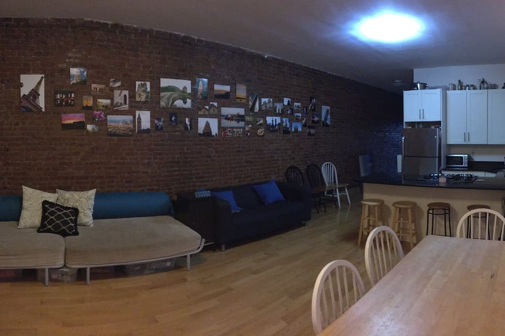 Lots of comfortable seating and beautiful exposed brick walls featuring photography from around the world
