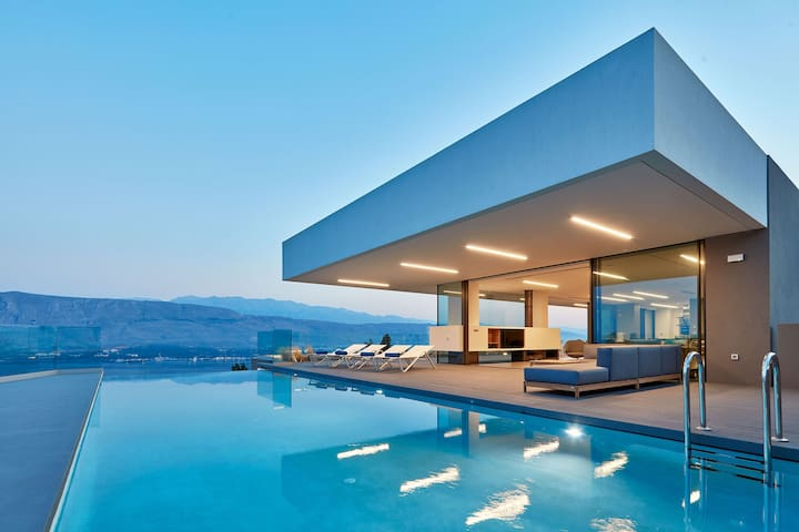 The villa is positioned to take advantage of panoramic views of surroundings