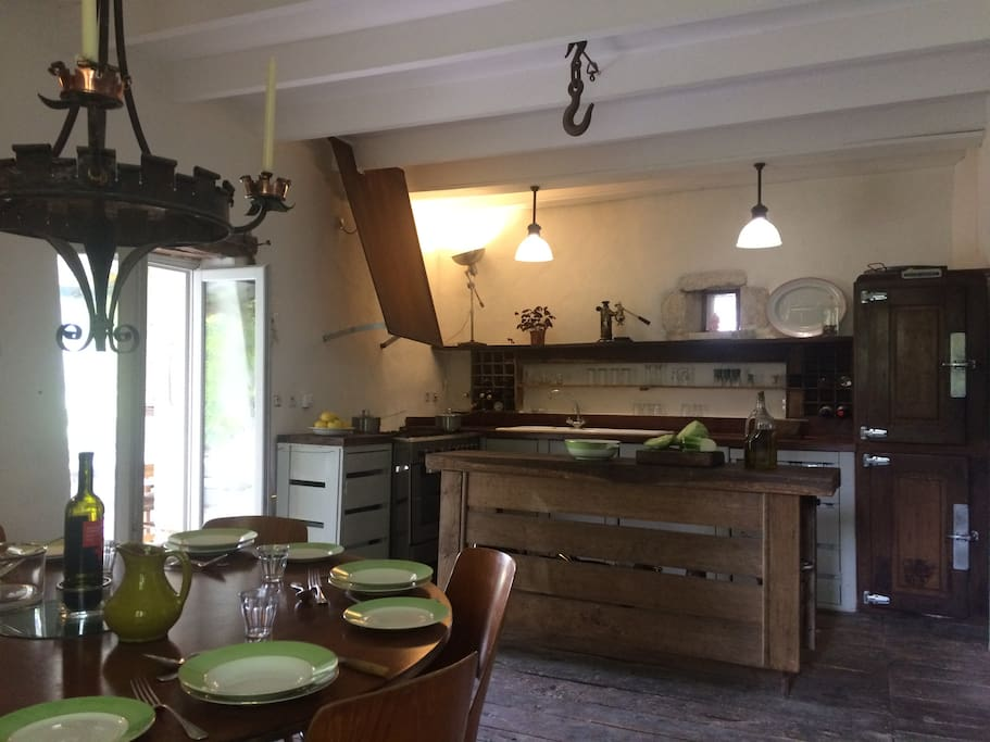 Kitchen / dining room in the main house which includes fridge/freezer, washing machine, dish washer and all the necessary appliances.  Five burner gas hob and huge oven.