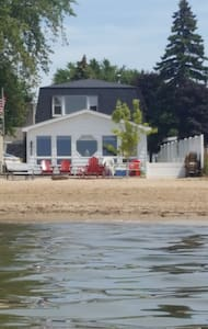 Waterfront home with sandy beach located in town