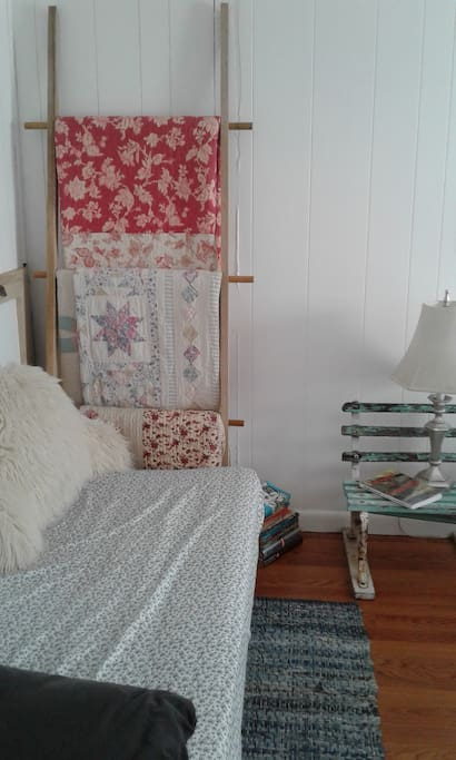 Bedroom 1 (left side) with Twin bed/daybed and new quilt ladder... love it!