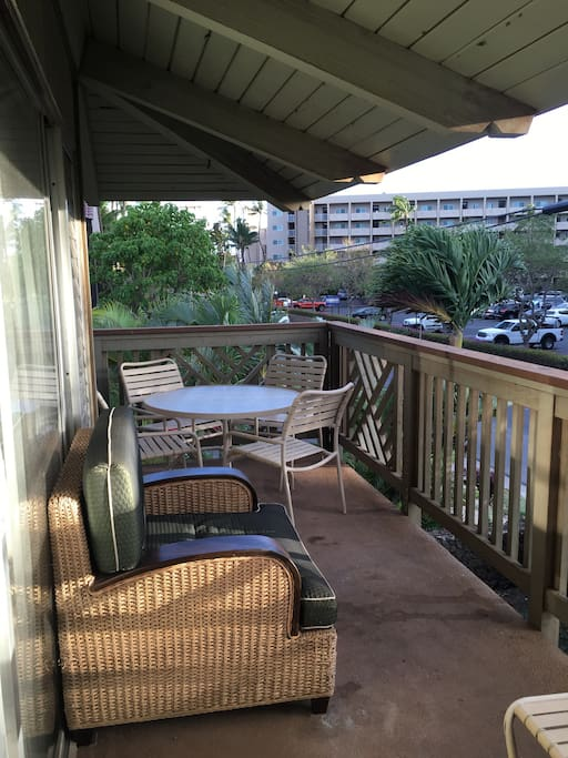 Wrap-around Lanai right across the street from the ocean! Plenty of seating and outdoor dining area.