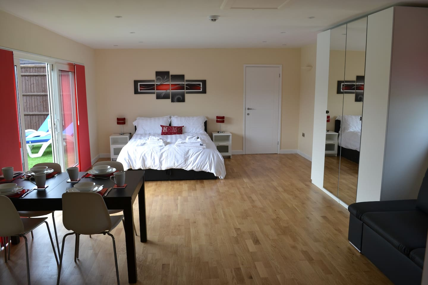 A spacious studio with bedroom, lounge and dining areas.
