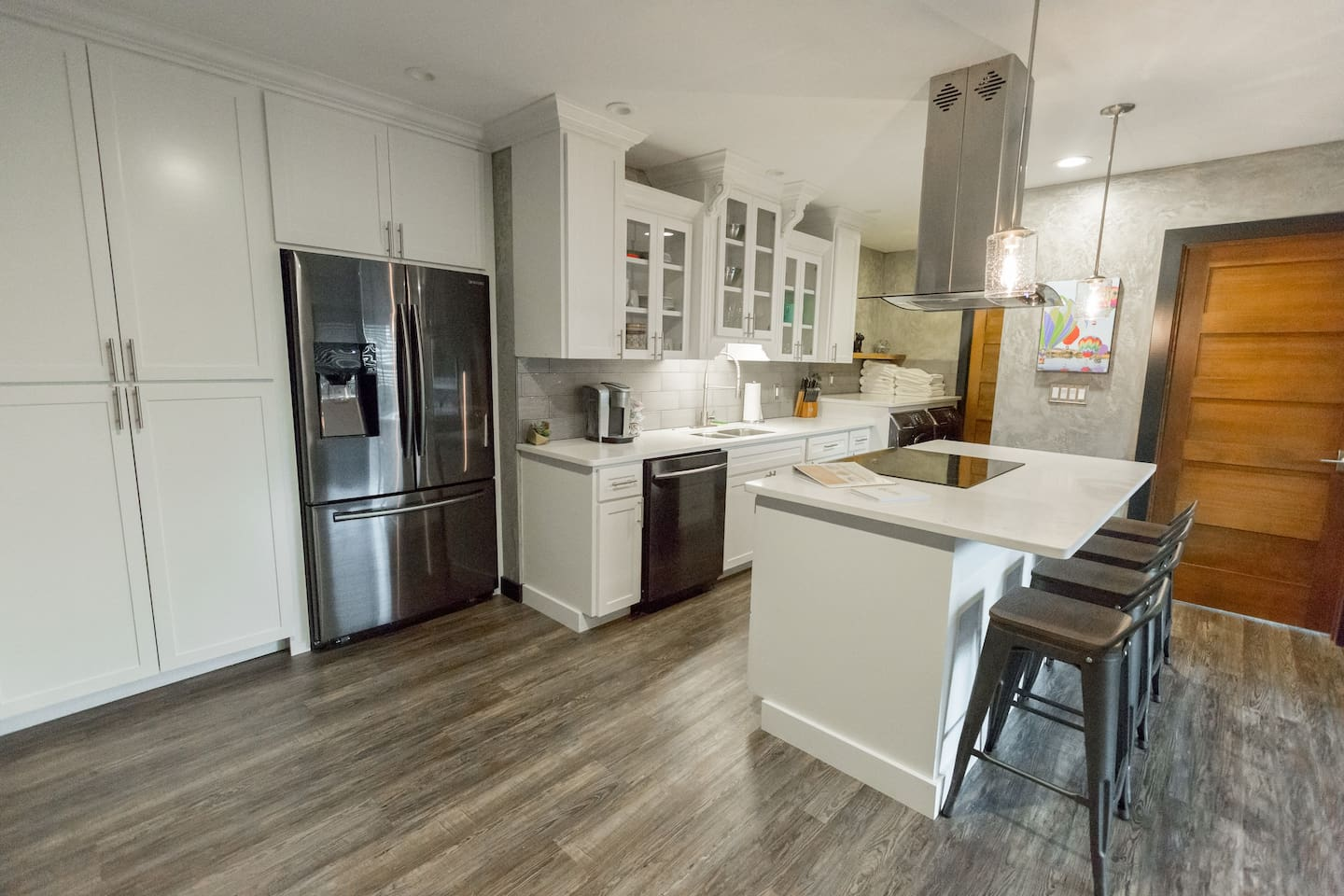 Ample storage and a generously stocked kitchen allows the option to entertain at home.