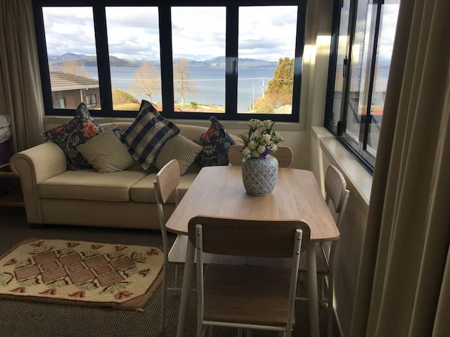 Another photo of lounge/dining area view to the lake