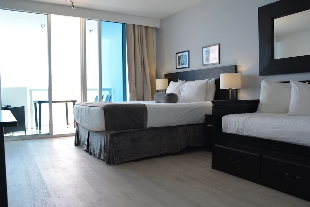 Return to this cozy room with a beautiful ocean view and step out on the balcony!