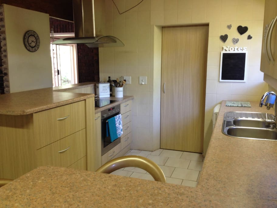 Enjoy the use of a fully equipped kitchen with a dishwasher and washing machine