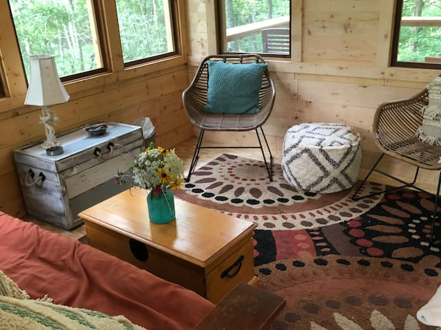 Your room in the trees. Inside Beautiful TREEHOUSE with sweeping views of woods