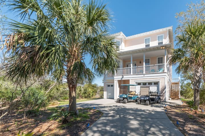 Stunning home on the marsh with Lagoon views, golf carts, access to Harbor Island amenities.