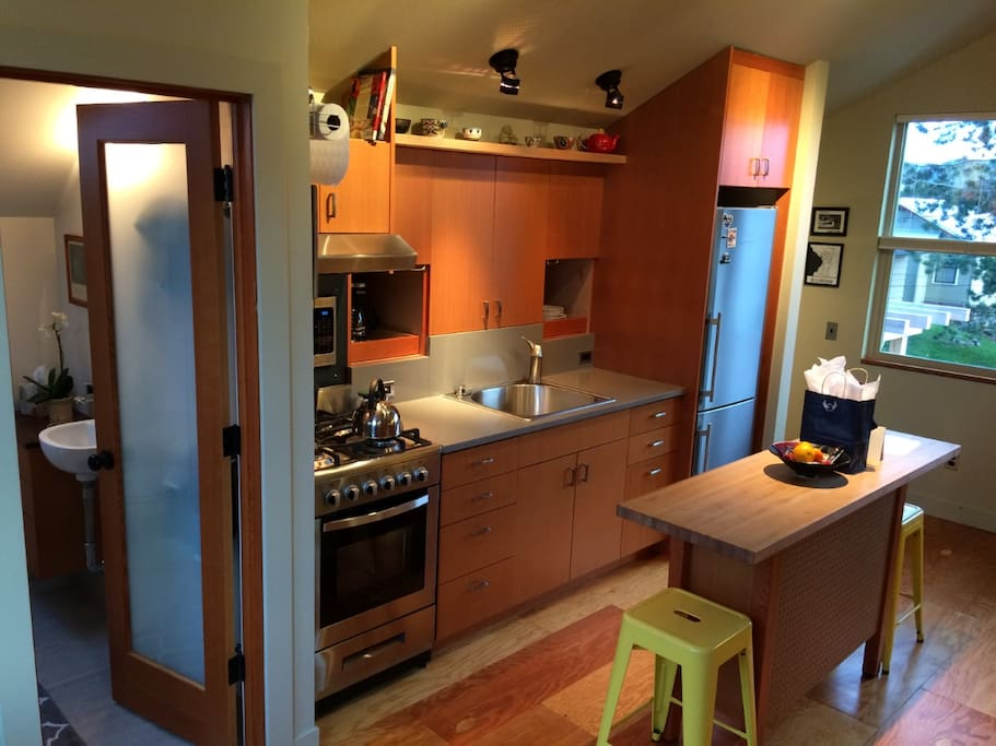Kitchen with lots of storage. Stove, oven, refrigerator, microwave, coffee pot and toaster.
