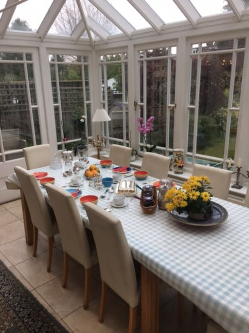 Plenty of room in the conservatory to enjoy the garden whilst eating the full English breakfast over the newspaper or TV news