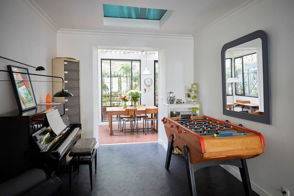 Ground floor: the living room (with a foosball) and view of the kitchen