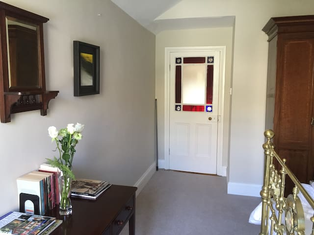 Upstairs bedroom with feature door