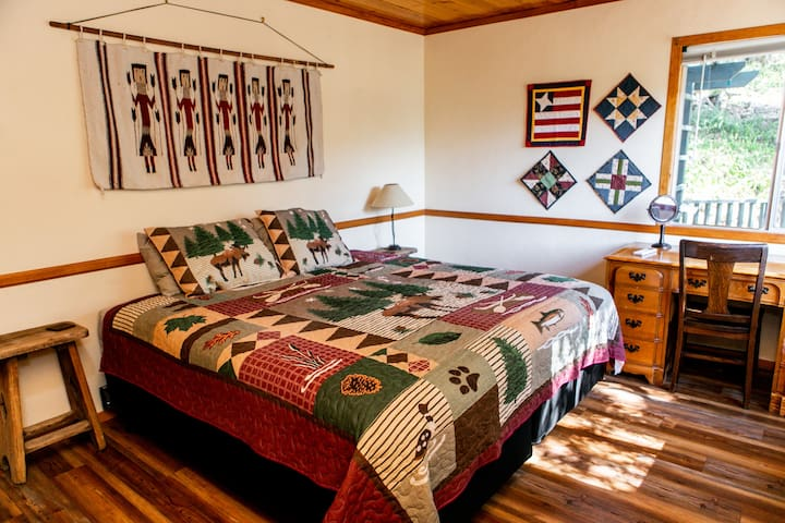 Enjoy sweet dreams on the King size bed in the main floor bedroom, and work (if you must) at a full size desk looking out at the scenery.
