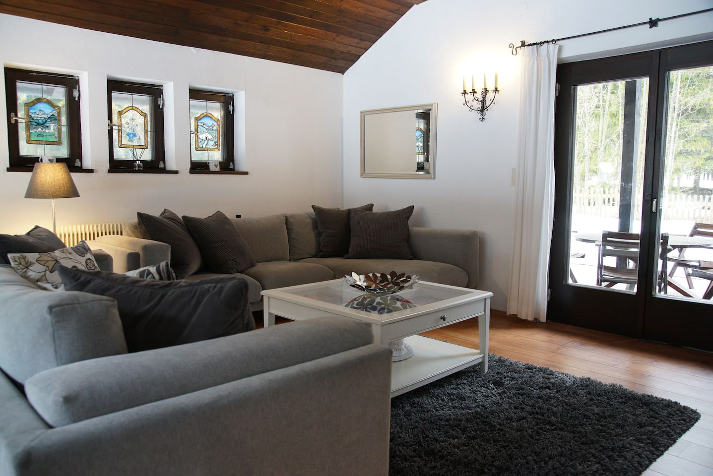 The bright, airy living room has plenty of comfortable seating and is a great place to relax. The room has views of the front garden and doors to the patio at the rear.