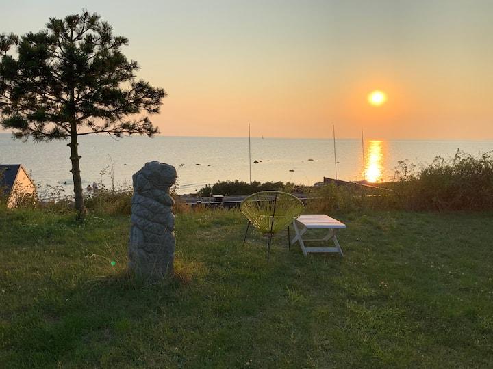 Summerhouse, spectacular sunsets, sculptures