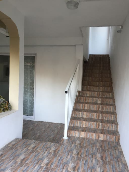 Stairs leading to first floor apartment