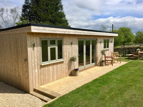 Kingfisher Lodge set in 7.5 acres with riverbank
