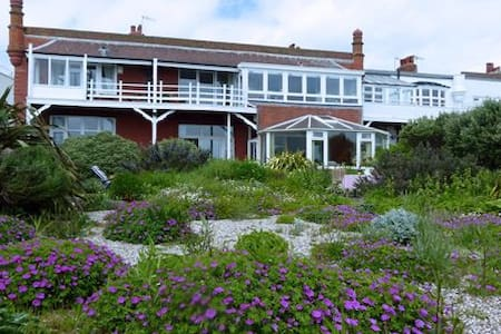Sunny seafront home with garden and beach access