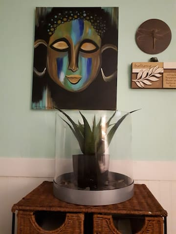 Local art and Buddah to meet you.  Sit and chill!