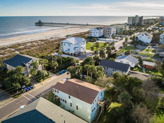 In this aerial photo, you can see our home (blue, bottom of photo) and just how close you are to the beach, the pier and Center Street.