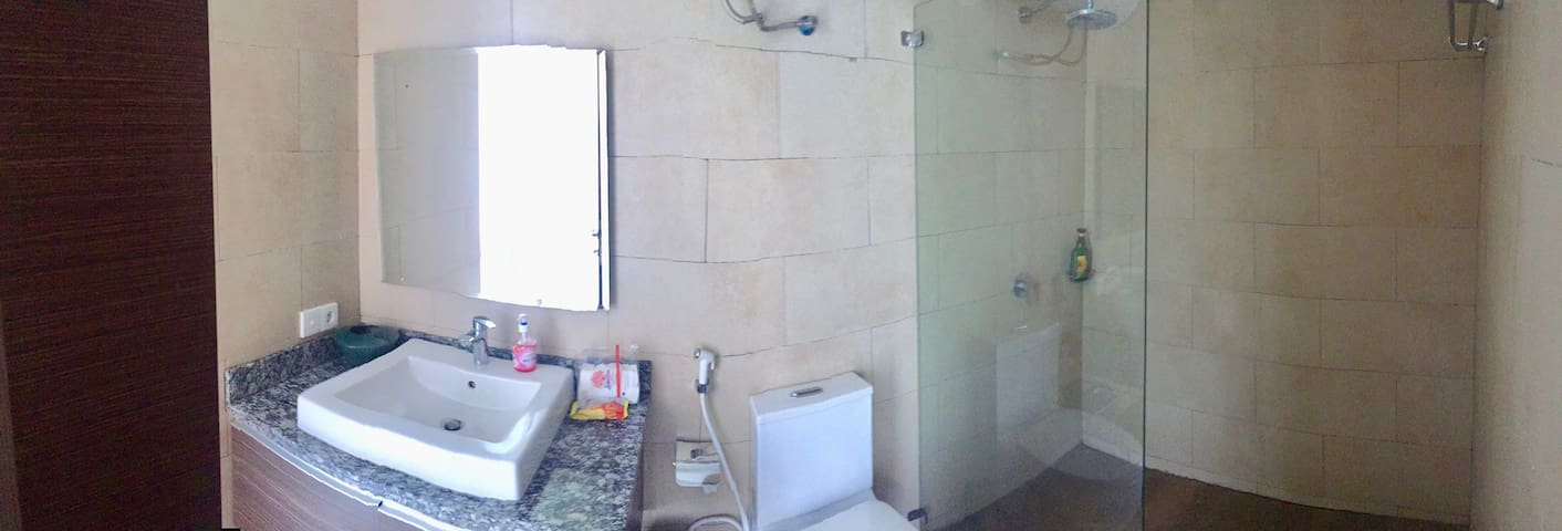 Private attached bathroom with rain shower