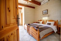 The first twin bedroom with ensuite bath-tub