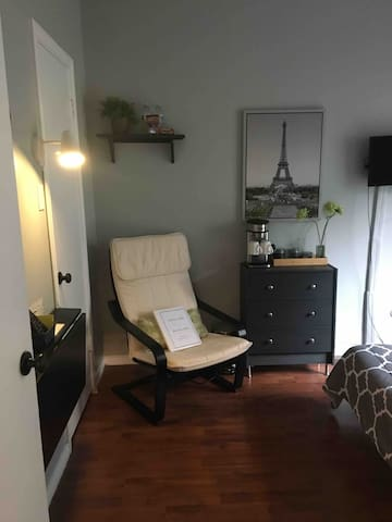 Comfy chair to relax, coffee service, snacks and a foldable desk!
