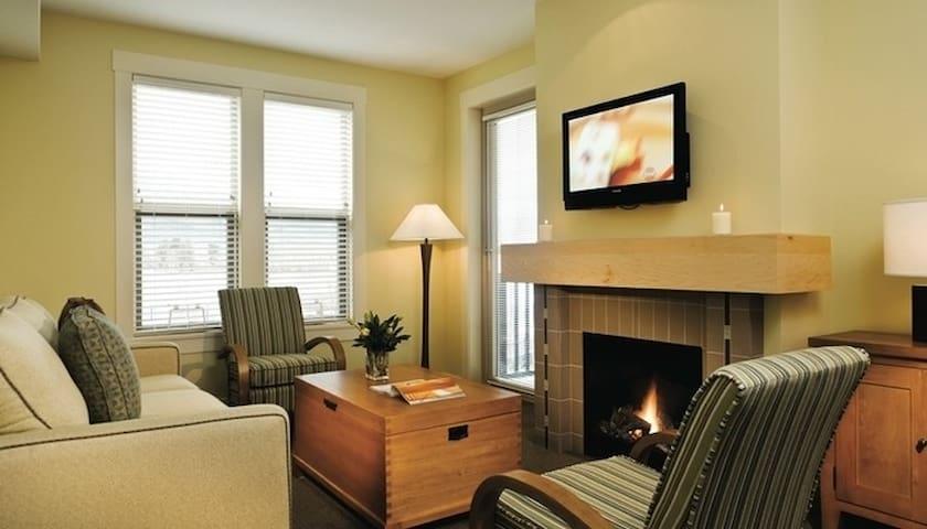 Neutral hues and large windows make this condo bright and inviting.