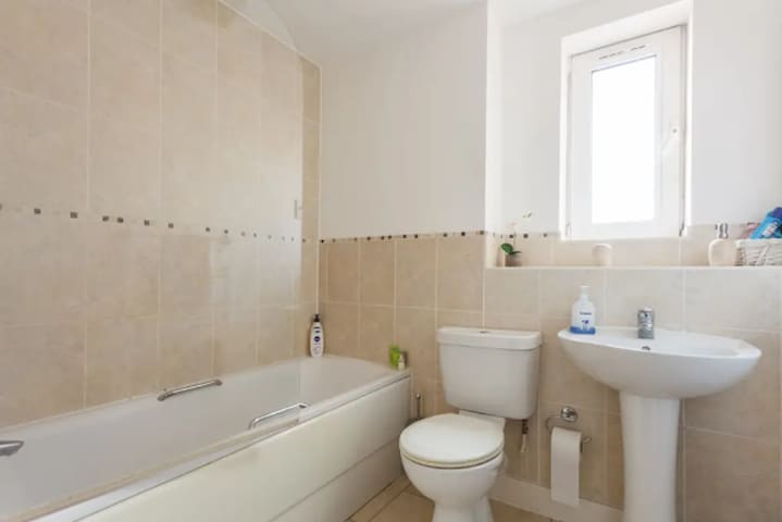 Large family bathroom with bath and over shower
