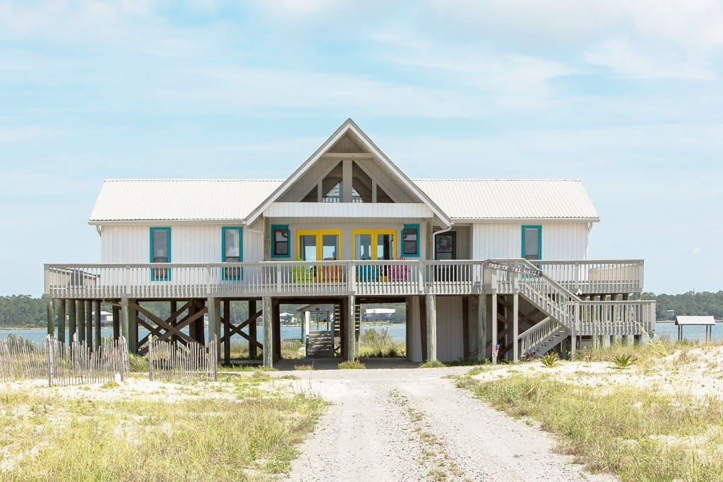 A gorgeous wraparound porch offers lagoon views on one side and gulf views on the other.