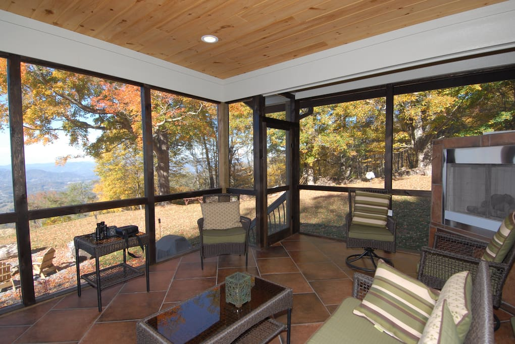 Screened in porch with gas fireplace. Enjoy the breeze and the view.