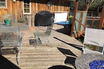 Deck just outside your suite with dining space, BBQ, Hot tub & Fire Table to be enjoyed all seasons with private tree lined pastural  landscape.