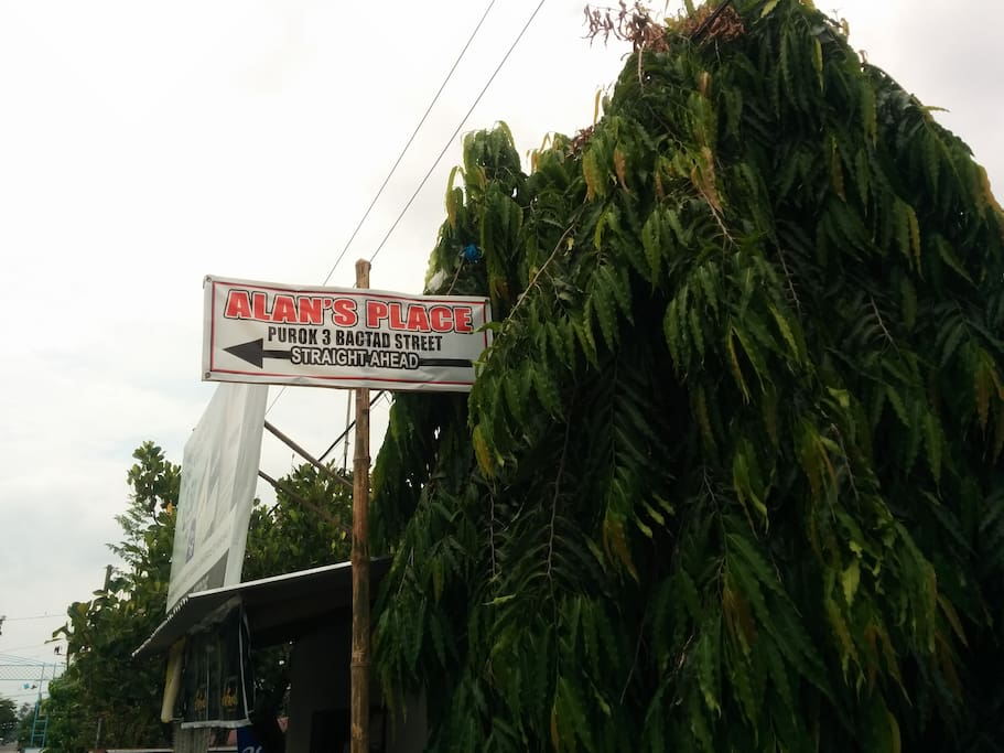 "Follow the signs to ""Alan's Place, Bactad Street"""