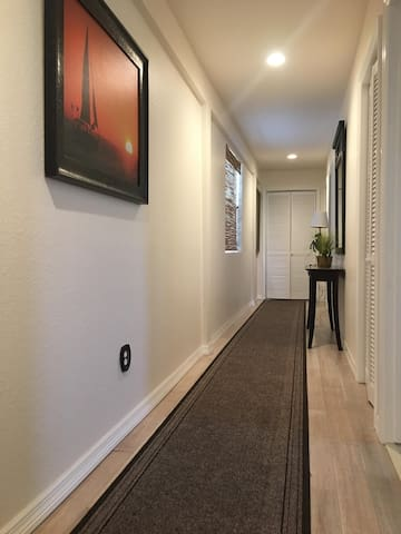 Hallway leading to the bathroom and bedrooms