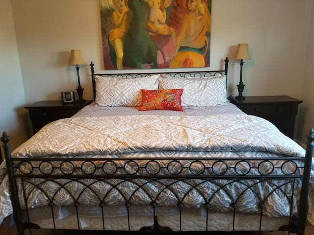 Comfortable king size bed with a 3 inch cooling memory foam topper.