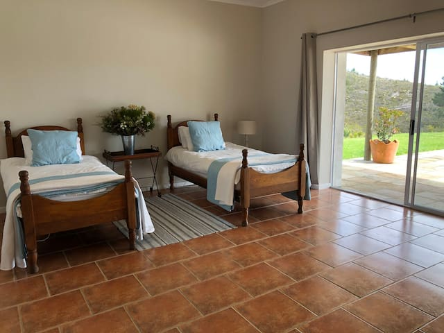 The fourth bedroom as spectacular views with two single oak beds and an ensuite study. However, there is no ensuite bathroom so guests staying in this room will need to make use of the other three ensuite bathrooms in the homestead.