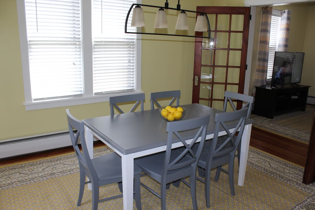 Spacious dining room with seating for six and convenient coffee station