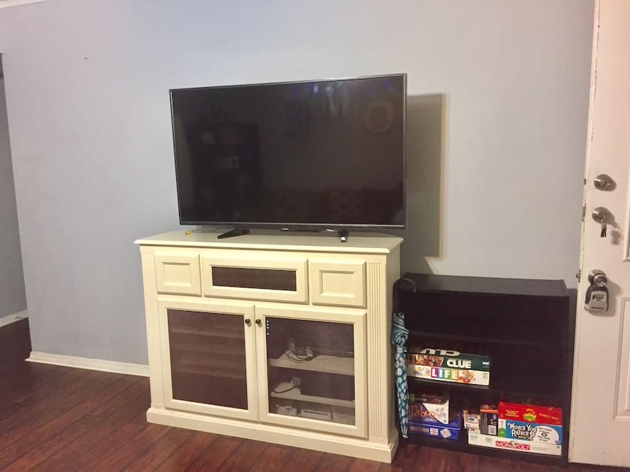 "55"" TV with access to Amazon Prime and Netflix. There are various board games as well."