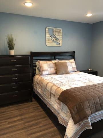 The bedroom features a high quality memory foam queen mattress.