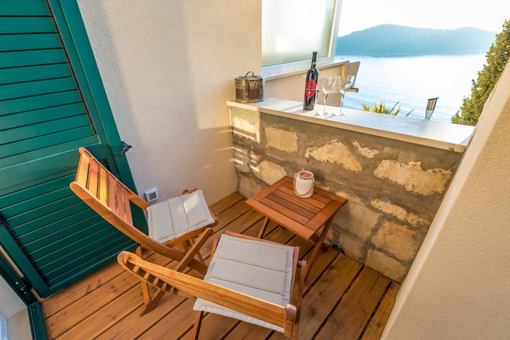 There is small balcony with an outdoor seating area