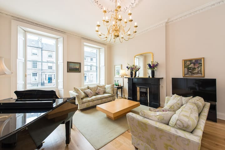 Grand and spacious living room with plenty of light streaming in