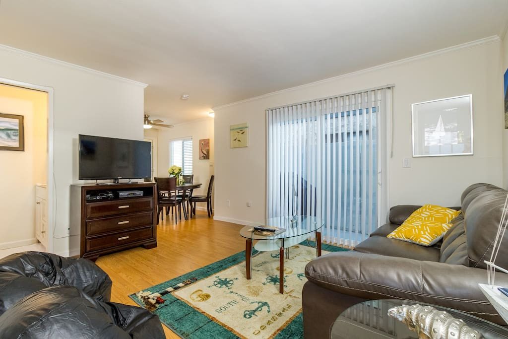 Living Room: Large flat screen TV with cable and dvd player. Half Bath on the left and open to the dining/kitchen