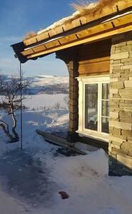 Flott tømmerhytte med utsikt på Oppdal, Skarvatnet