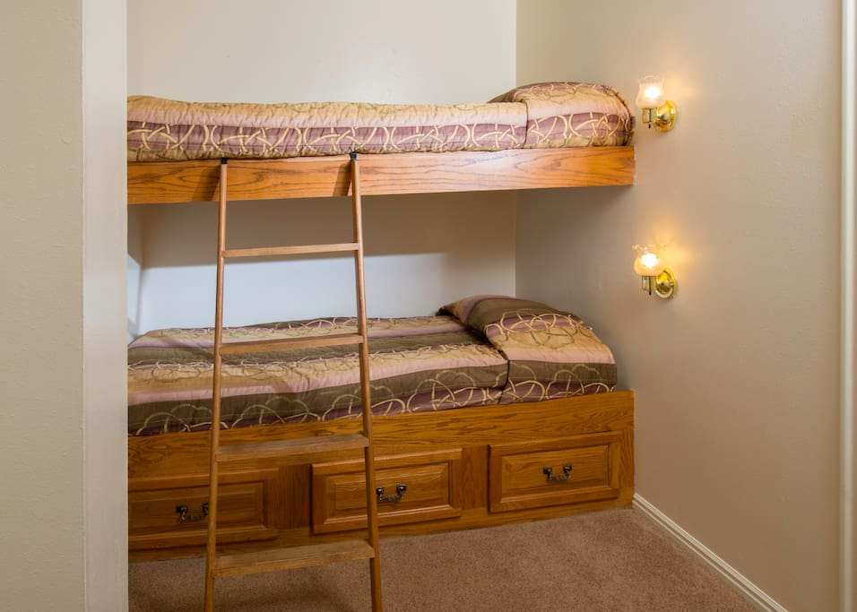 Bunk beds are located in a small loft area at the top of the stairs, near the master bedroom.